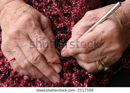 Senior or grandmother's hands crocheting