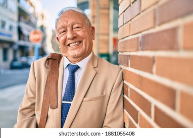Senior grey-haired businessman smiling happy standing at the city.