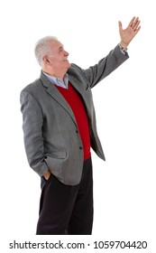 Senior grey-haired man raising his left arm showing something with a smile in a side profile view isolated on white
