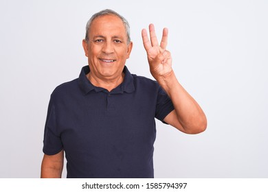 Senior grey-haired man wearing black casual polo standing over isolated white background showing and pointing up with fingers number three while smiling confident and happy.
