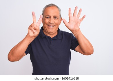 Senior grey-haired man wearing black casual polo standing over isolated white background showing and pointing up with fingers number seven while smiling confident and happy.