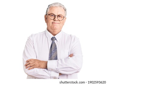 Senior grey-haired man wearing business clothes happy face smiling with crossed arms looking at the camera. positive person.