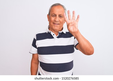 Senior grey-haired man wearing casual striped polo standing over isolated white background showing and pointing up with fingers number four while smiling confident and happy.