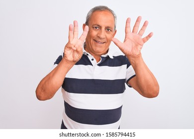 Senior grey-haired man wearing casual striped polo standing over isolated white background showing and pointing up with fingers number eight while smiling confident and happy.