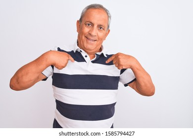 Senior grey-haired man wearing casual striped polo standing over isolated white background looking confident with smile on face, pointing oneself with fingers proud and happy.