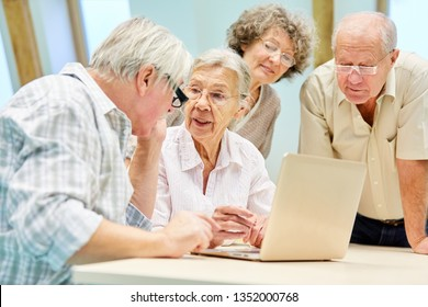 Senior group full of curiosity together on laptop pc and internet communication