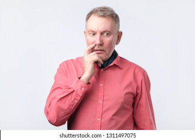 Senior guy wearing red shirt wondering and thinking about problems