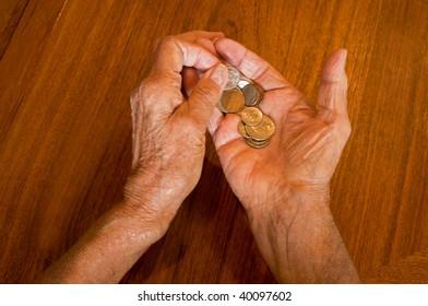 senior hands holding medications