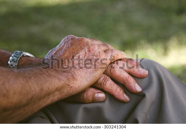 senior hands resting