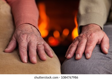 Senior hands resting near the fireplace - woman and man together in a serene moment