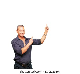 senior handsome man smiling and pointing upwards with both hands, towards the place where the publicist may show a concept.