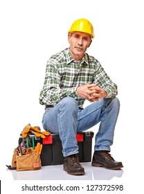 senior handyman isolated on white back view