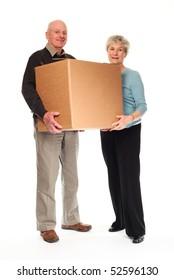 Senior happy couple on white background holding cardboard box together