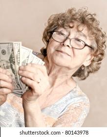 senior happy woman with money