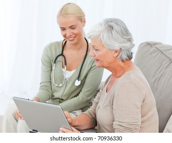 Senior with her doctor working on the laptop