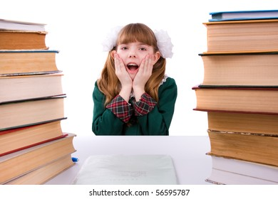 Senior high school student in uniform is sitting on the stack of book and study up. Young and beautiful schoolgirl  is wearing a traditional uniform is shocked by something.