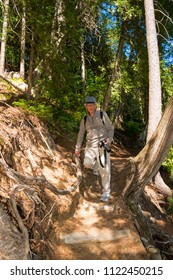 Senior hiking on a challenging forest trail