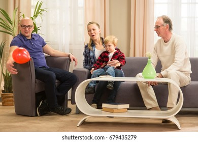 Senior with his family and grandson having time together