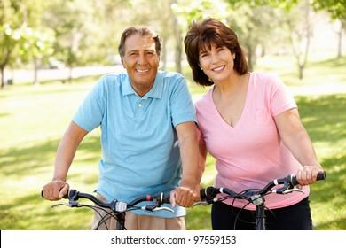 Senior Hispanic couple on bikes