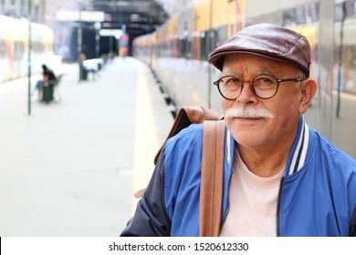 Senior Hispanic man at train station
