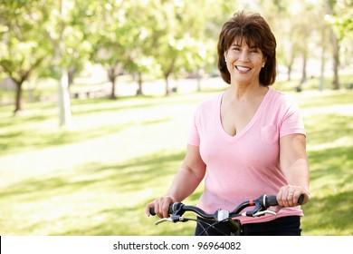 Senior Hispanic woman with bike