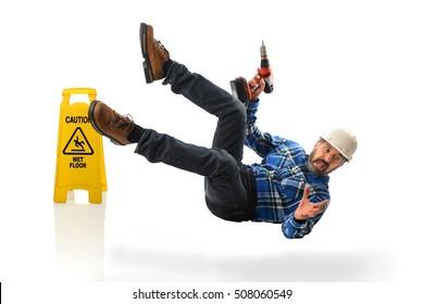 Senior Hispanic worker falling on wet floor isolated over white background