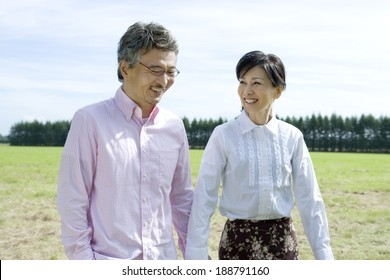 senior husband and wife holding hands