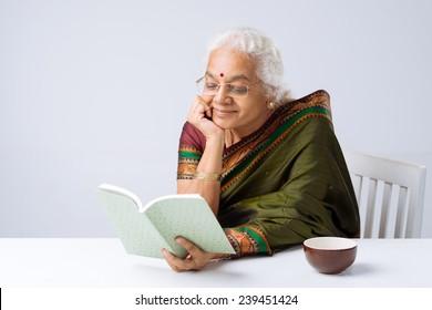 Senior Indian woman enjoying a novel