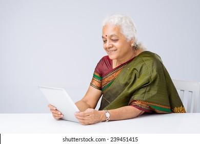 Senior Indian woman using a digital tablet
