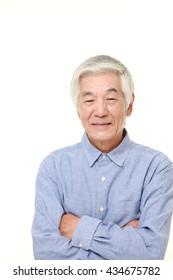 senior Japanese man in a blue shirts smiles