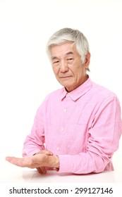 senior Japanese man checking his pulse