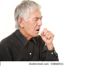 senior Japanese man coughing