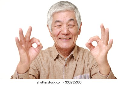 senior Japanese man showing double perfect sign