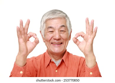 senior Japanese man showing perfect sign