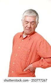 senior Japanese man suffers from lumbago