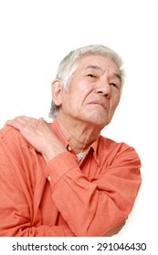 senior Japanese man suffers from neck ache