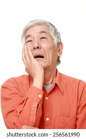 senior Japanese man suffers from toothache