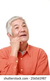 senior Japanese man thinks about something