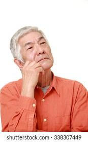 senior Japanese man worries about something