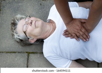 A senior lade with cardiac arrest or stroke receiving cpr