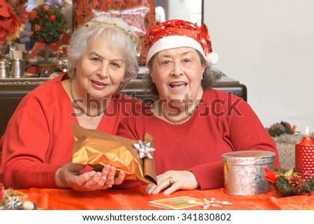 Ladies Christmas Gifts.Senior Ladies Christmas Gifts Living Room Stock Photo Edit