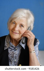 Senior lady busy by telephone call