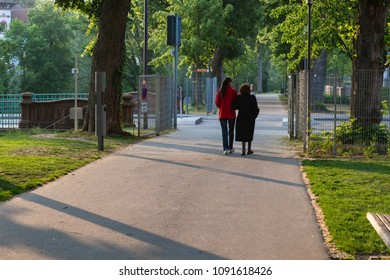senior lady with daughter at city park in springtime evening in south germany historical city