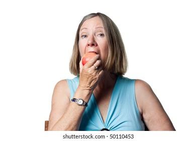 Senior lady enjoying an organic fresh apple