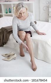 Senior lady has a pain her leg