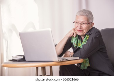 Senior lady having fun browsing internet content online