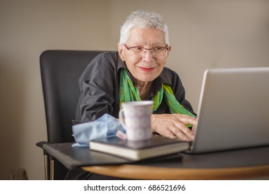 Senior lady having fun browsing internet content online