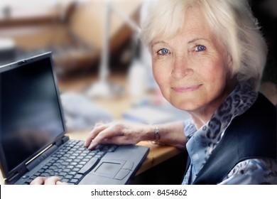 Senior lady with laptop ready to start