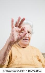 senior lady making okay sign
