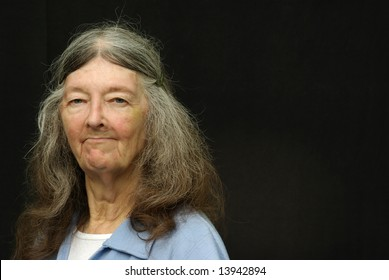senior lady off centered with black background